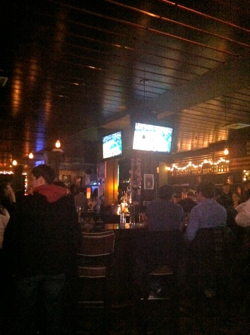 CLICK PHOTO FOR FULL PHOTO SLIDESHOW. Patrons sit inside Mass Ave Tavern/ PHOTO BY Hilary Ribons