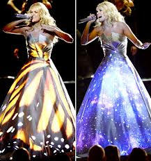 Carrie Underwood's stiff gown, onto which cheesy images were projected throughout her performance/PHOTO VIA usmagazine.com