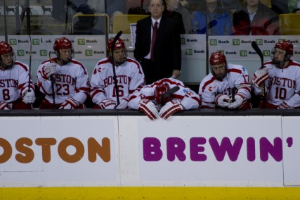 Senior captain Wade Megan hangs his head on the bench after Northeastern University scores its third goal in the first game of the Beanpot at TD Garden February 4. PHOTO BY MICHELLE JAY/DAILY FREE PRESS STAFF